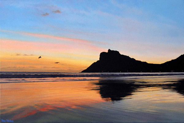 Oil on canvas seascape painting from Hout Bay Beach looking towards Hangberg and The Sentinel at sunset by artist Peter Strobos.