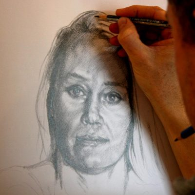 Artists Peter Strobos sketching the portrait of the pencil study.