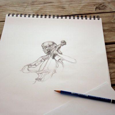 Artist's sketchbook with fluidity concept sketch in progress.