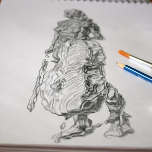 Drawing paper and tools with completed fluidity sketch.