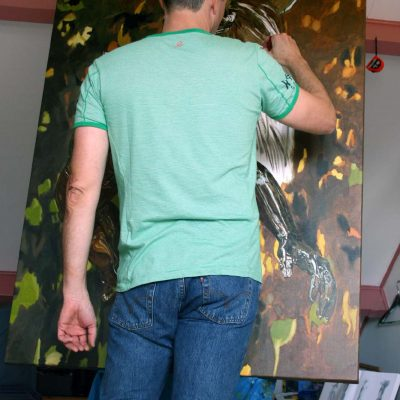 Artist Peter Strobos painting in the studio.