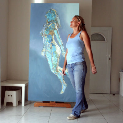 Model in artist's studio, with painting 7 in early progress.